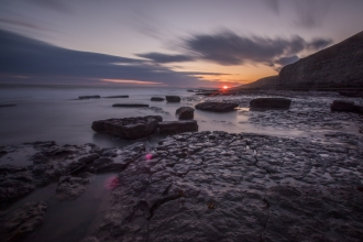 Sunset over a rocky beach _ Chris Lawrence